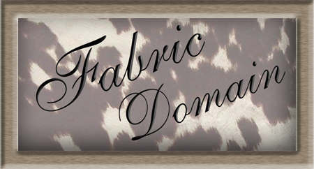 Fabric Domain logo with cowhide background and frame