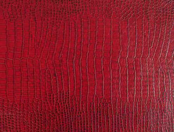 Red lizard faux leather fabric that looks like snake skin