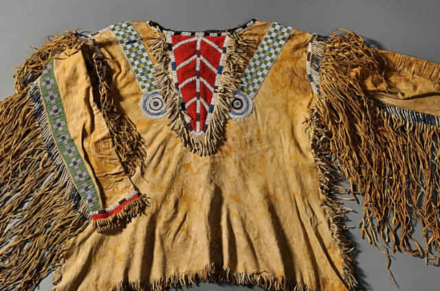 Southwestern plains indian artifacts of colorful leather clothing